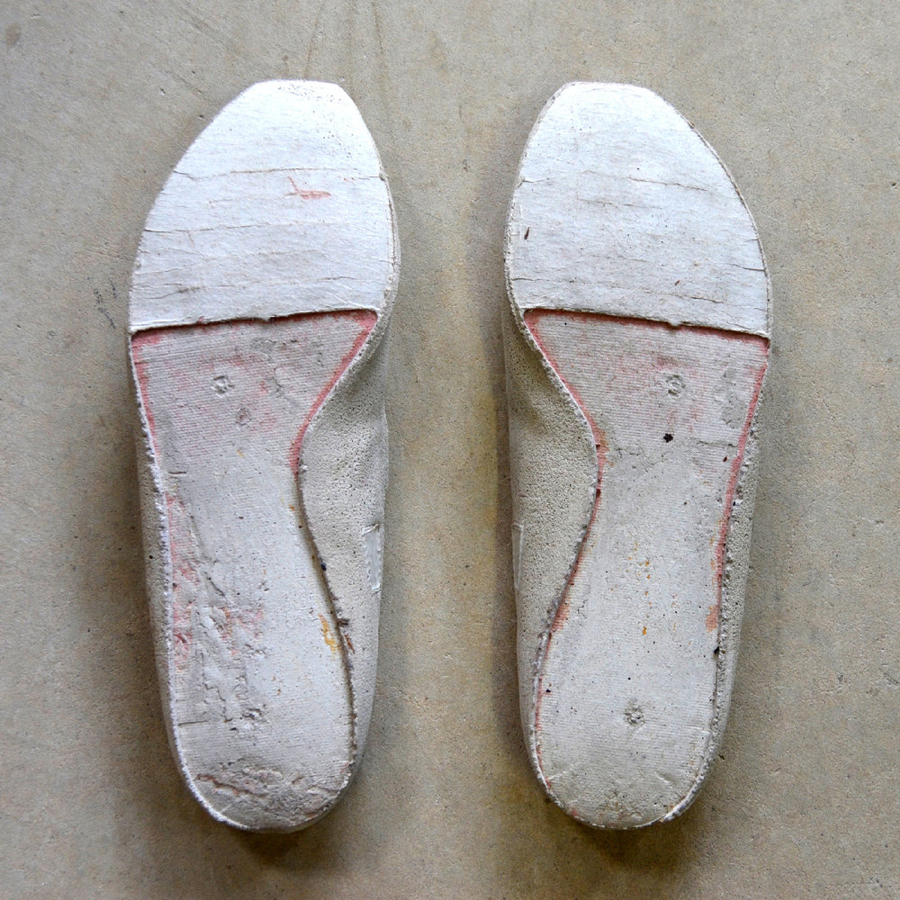 I cast the interiors of well-worn women's shoes. The castings unfold the structure of the shoe, as well as the foot's pressure and form. The process of inversion exposes the insole- the surface where the shoe receives the body. Wear, residue and markings reveal traces of experience inside. 50+ pairs inhabit a four-floor stairwell of a school and former hospital. The vertical chamber is occupied by audio of the women's voices; they speak of embodied experience and physical wear in the world of undervalued carework and maintenance labor.