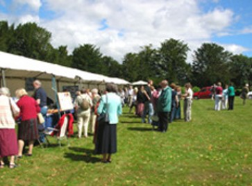 Visitors enjoying the sunshine at the JASUK AGM on the lawns of Chawton House