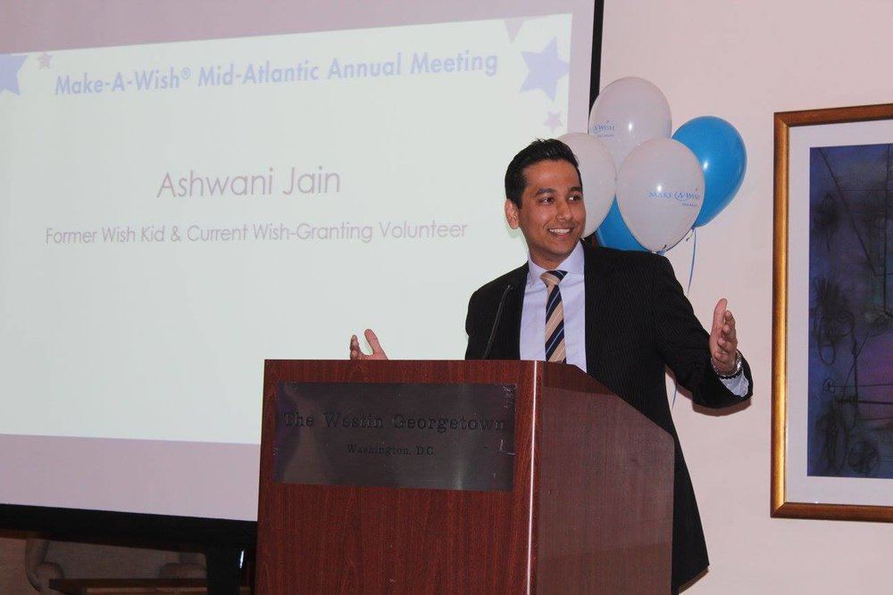 Ashwani Jain speaking at a Make-A-Wish Meeting.