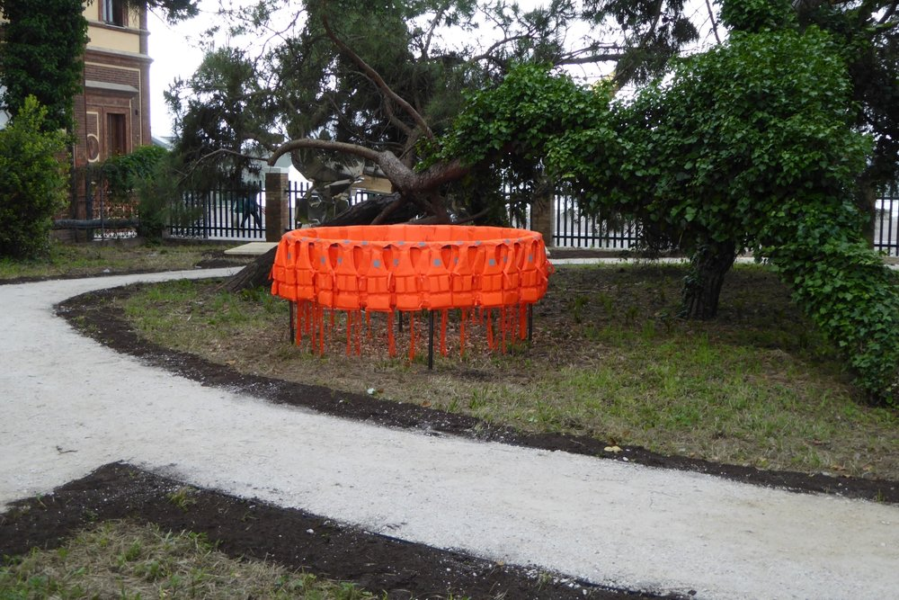 Déplacement (Smuggling Pod), 2017, Life-jackets, Steel, 200 cm diameter x 100 cm, Installation Giardini Marinaressa, Venice ITALY