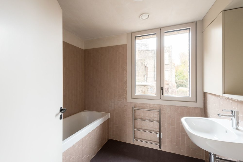 Shepherdess Walk - Apt 2 - Bathroom with bath tub.jpg