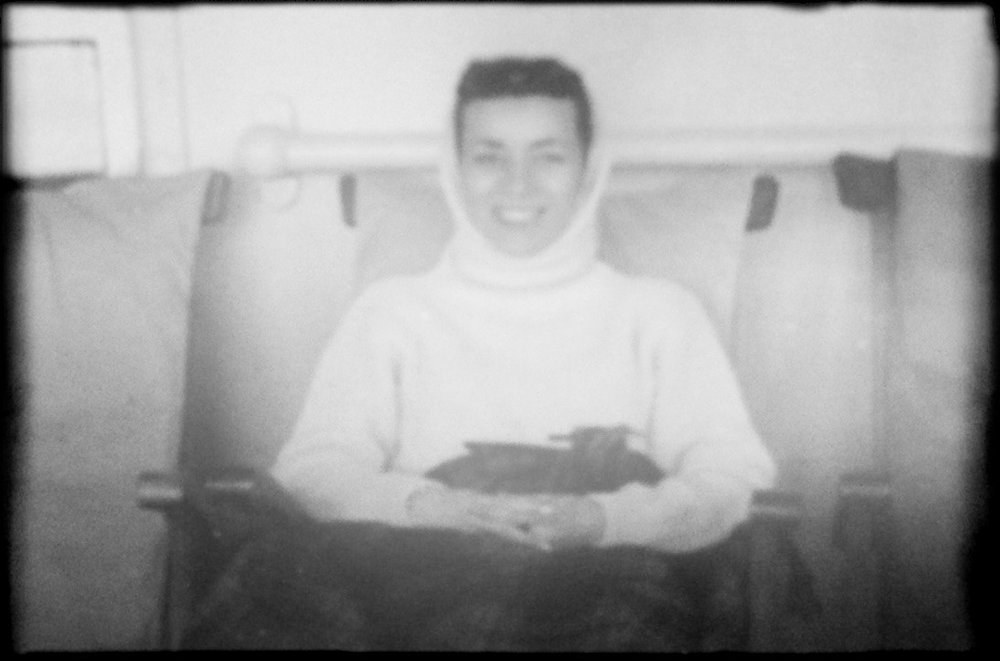 Mom sitting on the deck of the Queen Mary. My father was seasick the entire trip and never left the room. I'm guessing it wasn't the best honeymoon.