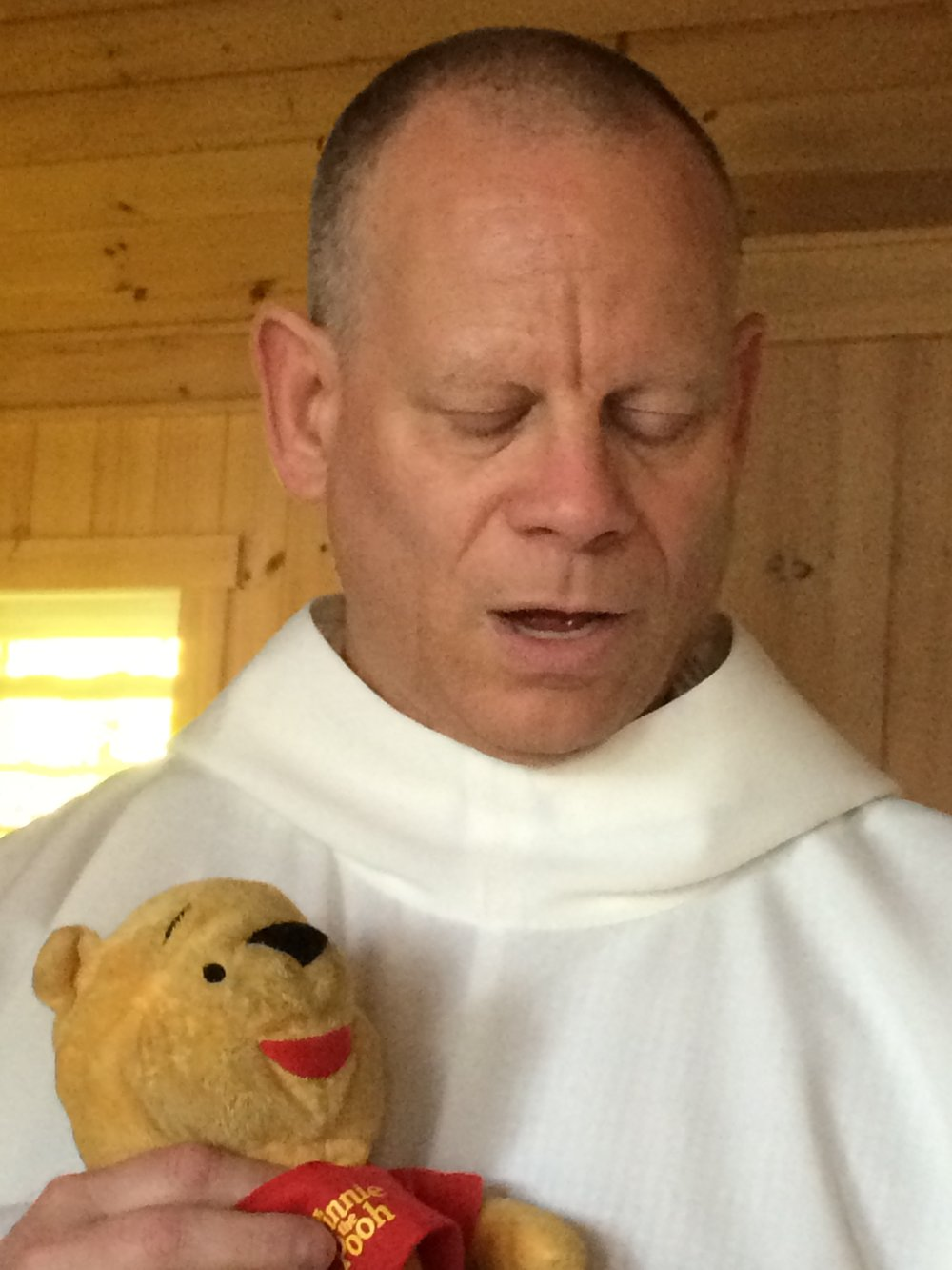 David. What he is doing in his clerical robe with Winnie The Pooh I do not know.