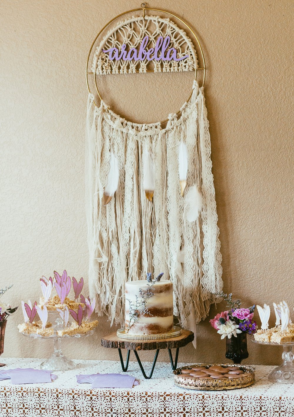 Dessert table featuring our glass cake servers, mirrored tray, dreamcatcher, lace tablecloth, and amethyst goblets