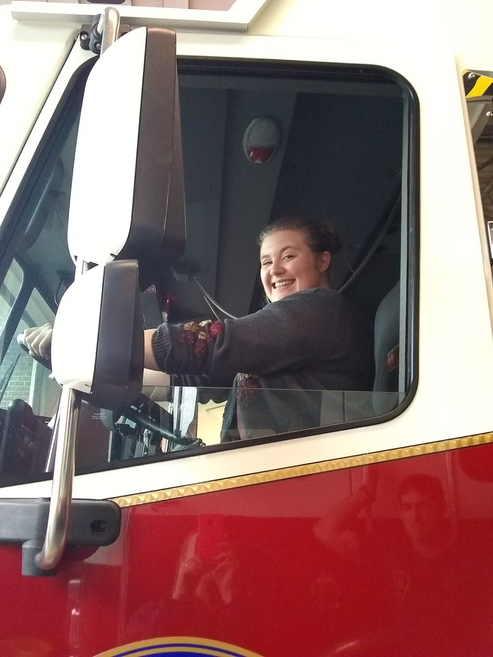 So, the guys at the fire station appreciated the cookies . . . and gave the girls a tour of the station!