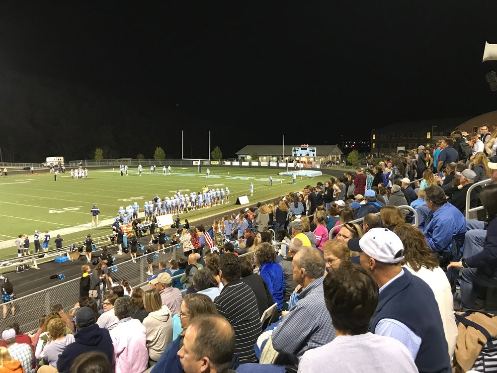 After a Watauga High School football game, we handed out frisbees to this fun crowd!