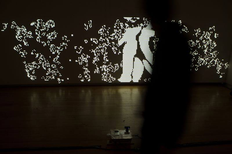 Projection mapping visual interactive installation with a motion sensitive camera