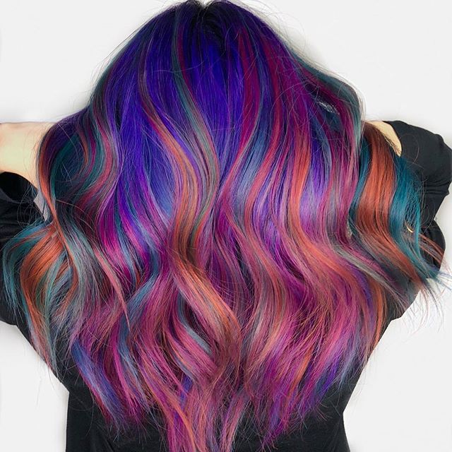 Rainbow dream for our guest Whitney!!!!! It took a few hours and ii is something high maintenance so be aware that when you want vibrant and vivid colours, you are committing to something!!! But the fun you have with the results is just SO worth it!!!! Done by @a.b.hair today at the shop!!! Few spots open during the day before Christmas, book before its too late!!!! #vividhaircolor #rainbowhair #citybeats #redken #wavyhair #dysonhairdryer #hair #hairtransformation