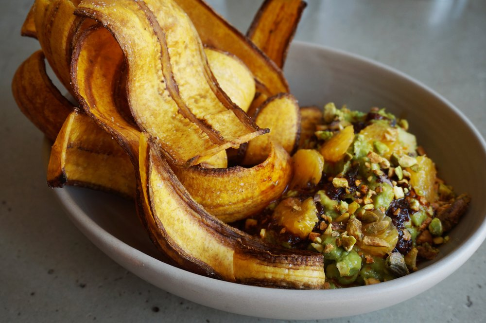 """El Gran Combo"" guacamole with guajillo-pistachio mojo, orange and plantain chips at Candela Latin Kitchen. Photo by Mark Antonation"