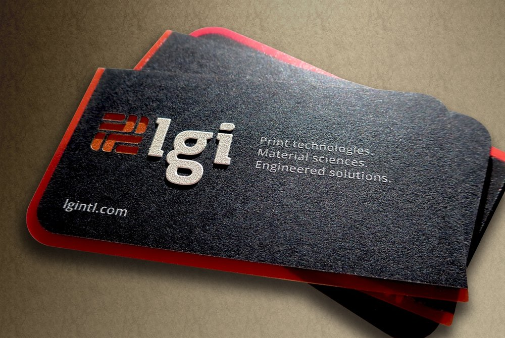 The front of Lgi's business cards featuring an embossed 3D polymer and debossed laser cut reveals