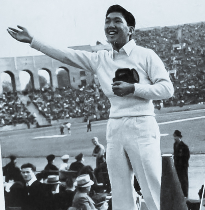 "Hitoshi ""Moe"" Yonemura, here about 20 years old, stands before the crowd as ""yell leader"" at a UCLA football game.  The photograph is from page 244 of the UCLA yearbook for 1940."