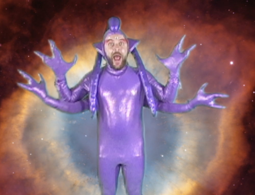 INFOMERCIAL ALIEN (3,000) - One of the stars in Jimmy's moon real estate infomercial.