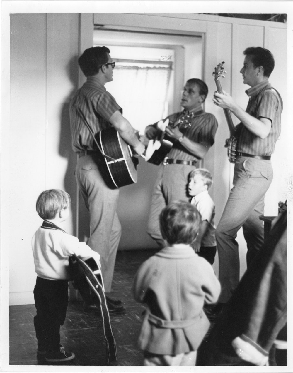 Josh Reynolds singing with the KT boys, next to his dad, center frame.  Mikael Stewart and Jodie Shane in foreground. (circa 1964)