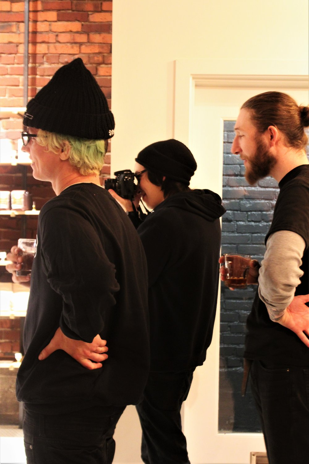 From left to right: Alex, Marcus, and Taylor Best, discussing photos during our shoot