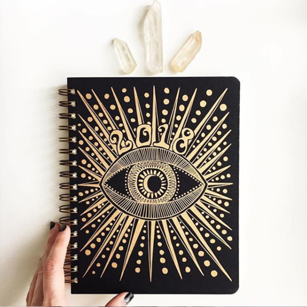 2018 Calender - This sturdy spiral bound notebook features both full month spreads, a week at a glance, monthly and weekly to-do lists, and plenty of blank pages for notes and sketches. The size is perfect to carry around with you, but large enough for the most detailed note taker. 230 pages, printed in black on ivory paper - includes year, month and week at a glance spreads. 25 blank pages for notes and flexibility and a folded pocket to keep important papers and secret treasures! The cover art is printed in gold on black and is ready to help keep you focused on all your dreams and projects for the next 12 months, January-December 2018.