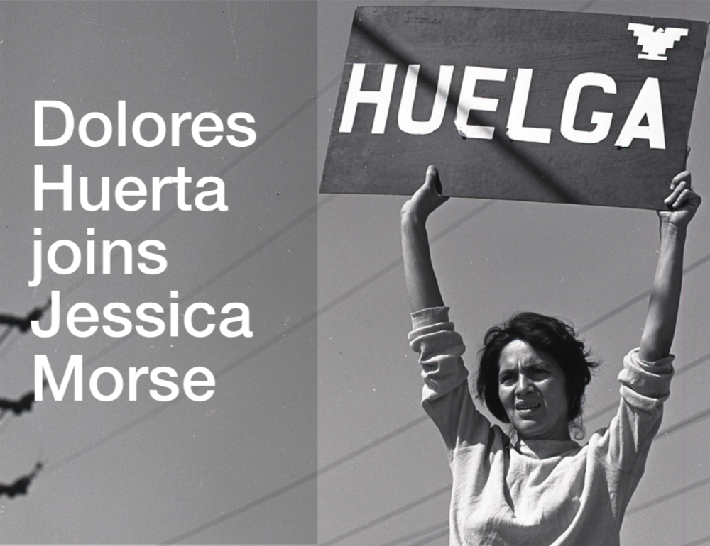 "Dolores Huerta holding a ""huelga"" sign."