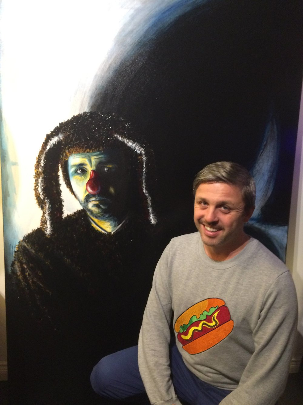 Daniel Mudie Cunningham with his portrait by former art teacher Iain Wallace.