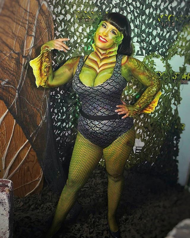 "💚 photos by the incredible @instaguygil 💚 For Halloween this year I went all out as ""The Babe from the Black Lagoon"" with amazing body paint and prosthetics by @crowcaw_fx . Thank you Jonathon for making me the true creature queen I was meant to be!!! @clubarea51slc  Bodysuit and fishnets from @iconoclad and stealthing my favorite satin corset from @orchardcorset . . #creaturefromtheblacklagoon #gillman #sfxmakeup #monstersholdingbitches #mhb #halloween2018 #clubarea51 #blacklagoon #pinup #horrorpinup #orchardcorset"