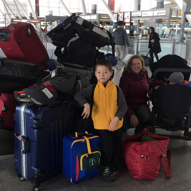 Our suitcase, my older son (front), mother-in-law (back), and younger son (in the stroller)