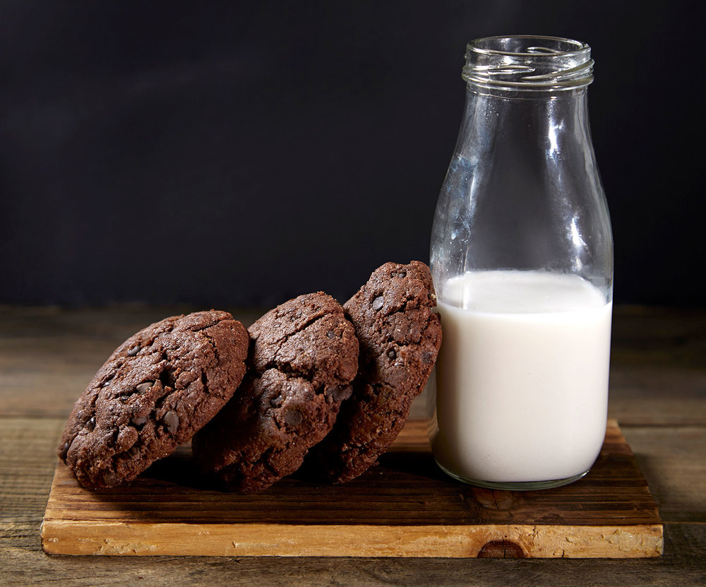 MILK AND COOKIES - Our vegan chocolate chip cookies are best paired with a cold glass of fresh almond milk.