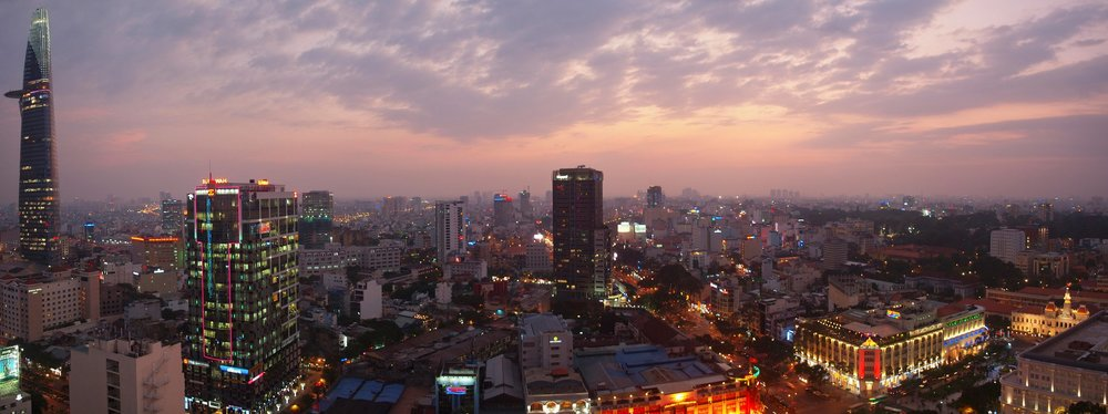 Dusk in Ho Chi Minh City, Vietnam; Photo credit:  Tom Parfitt  (2013), CC BY-NC-SA 2.0