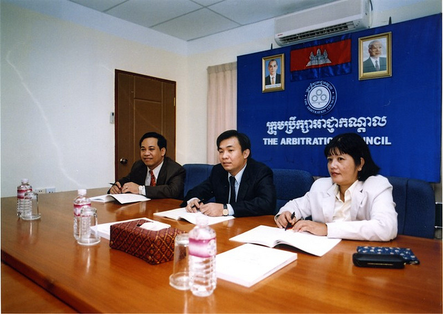 A meeting at the  Cambodian Arbitration Council ; Photo credit:  International Labor Organization ; CC BY-NC-ND 2.0 (not to be confused with the  National Commercial Arbitration Center )