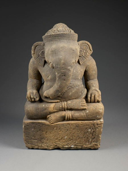 A sculpture of the Indic god Ganesha. Made of sandstone in Cambodia in the Angkor style in the 10th century. Author:  Sean Pathasema ; Collection: Birmingham Museum of Art. CC BY 3.0.