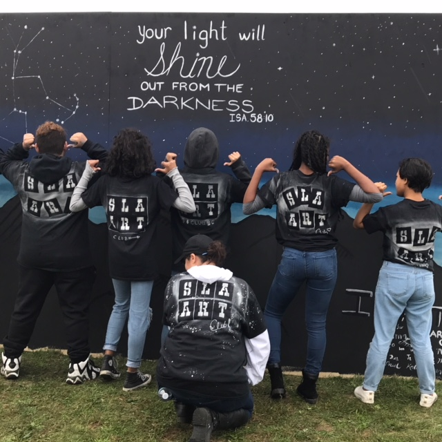 Students from the SLA Art Club painted a mural during Southern New England Conference's Impact New Bedford on Sept. 30. The students didn't let the rain stop them from spreading their light.