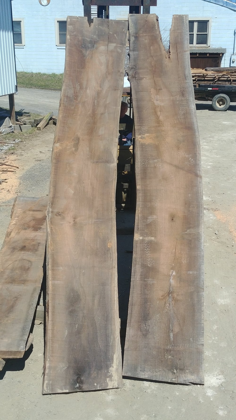 $1800 - Black walnut bookmatch25-28 inches wide14 feet longheart check on one side1-2 knots in each