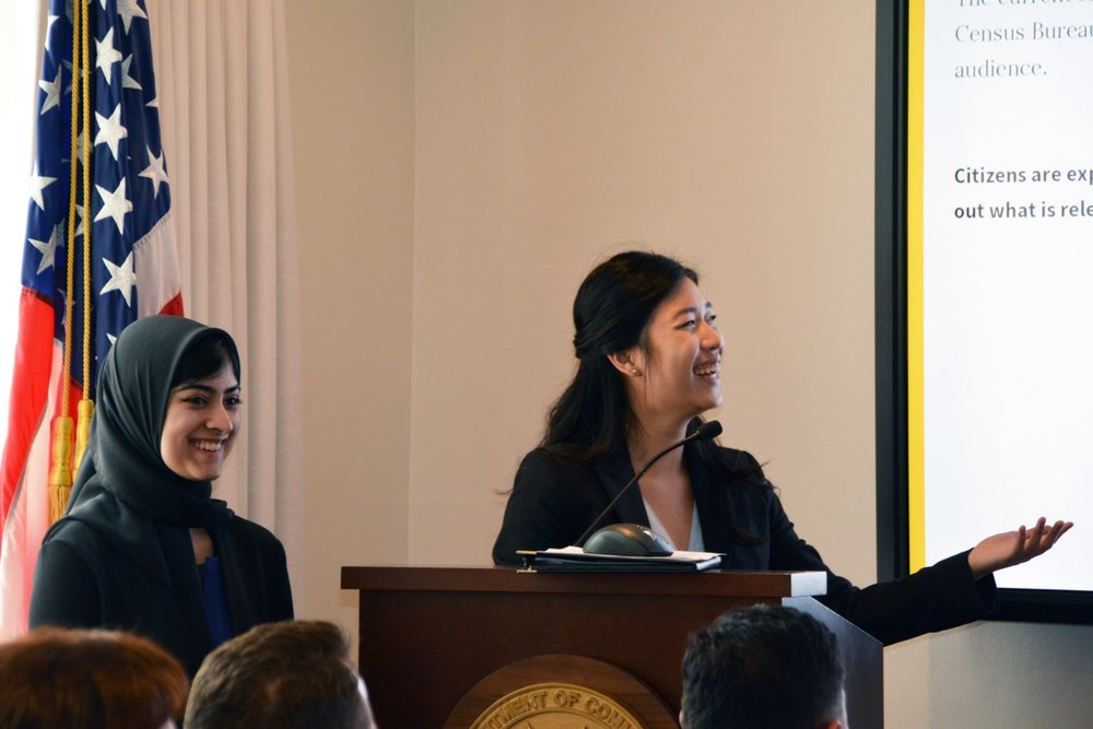 Anna Wang (R) presents on Demo Day at the U.S. Department of Commerce.