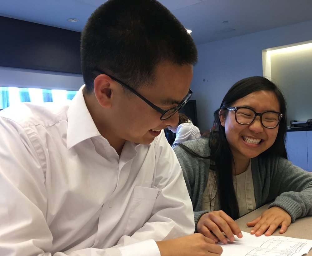 Andrea Chen (R) discovers her project assignment for the summer.