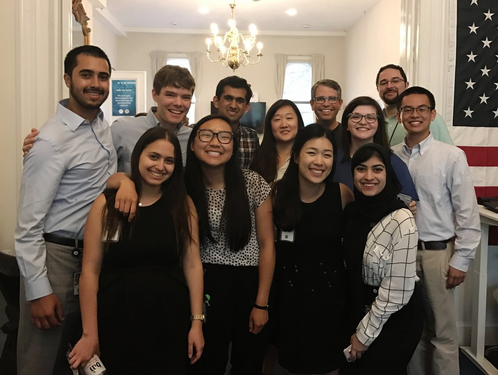 Mariam Baqai (front row, right) and other fellows visiting with Matt Cutts, the Acting Administrator of the United States Digital Service.