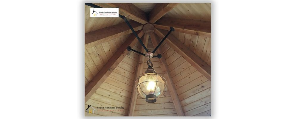 Black Iron artwork lighting a Winnipesaukee island home with some lighting flair.