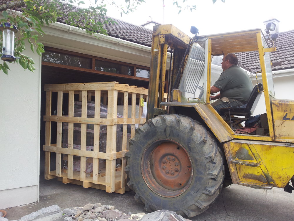 In 2013, with the support from my darling husband, Wicklow LEO, and MFI Ireland, I converted our garage into a purpose-built Nougat Kitchen.  In this photo Joe (our neighbour) brings the pallet containing my new machines into a building site A.K.A - Nougat Kitchen.