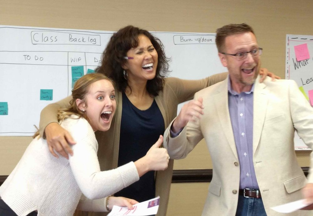 Learners in class having fun while learning and teaching! Yes, in our class, learners teach back to the class.  We learn better when we are having fun. Having fun boosts the positive emotions which activate the learning centers in our brain.