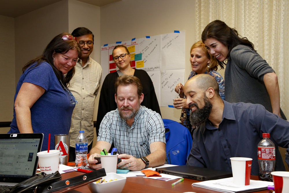 Scrum team in class doing a sprint review of the product they just built in the sprint.