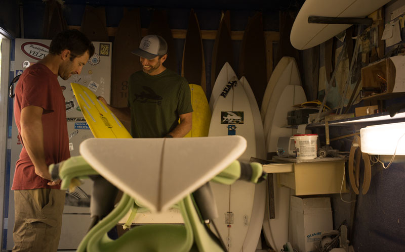 Fletch and Jason Slezak discuss the finer points of fin placement on a kiteboard.