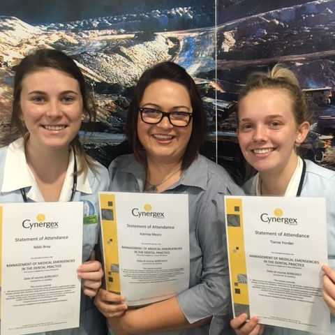Proud staff members with their Certificates