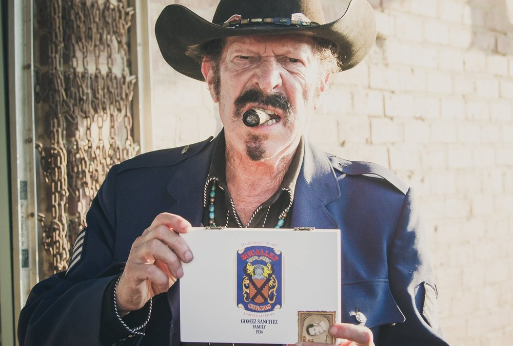 Kinky Friedman and a box of Micallef Reserva Limitada Pravada in Fort Worth, TX