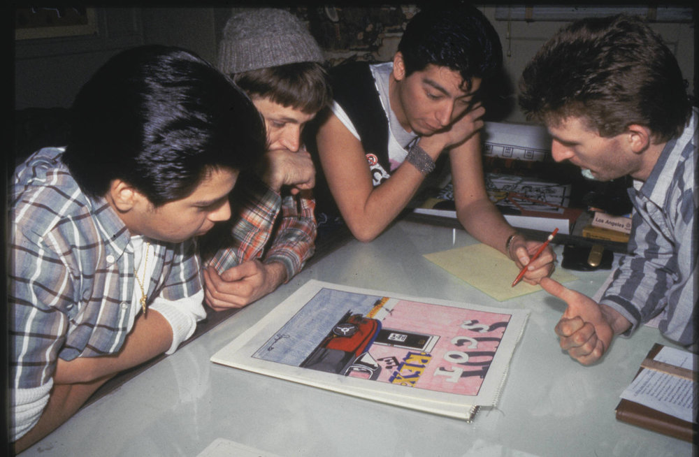 Artist from the first ateliers reviewing sketches, 1983