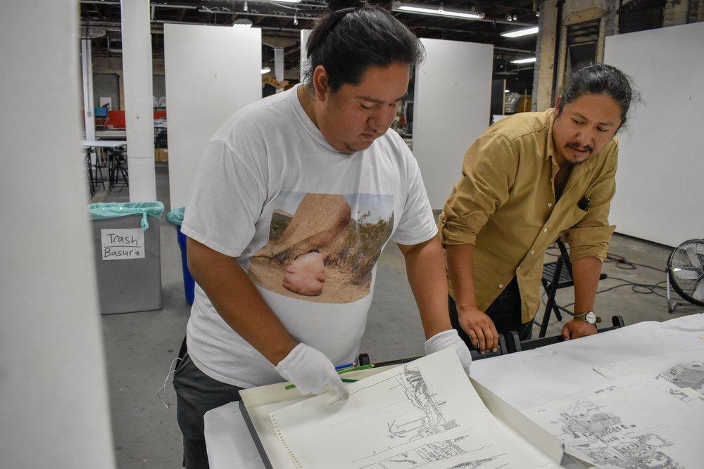 Juan Silverio in the process of choosing drawings from Manuel Lopez's collection for consideration in  Hacer, Deshacer, y Rehacer .