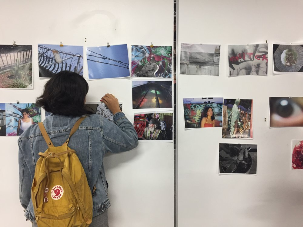 S.O.Y Artista student placing photographs for the Summer Exhibition on Saturday August 4th.