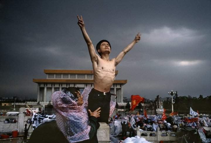 A man flashes the symbol for peace in Tiananmen Square, in Beijing, in 1989  Stuart Franklin—Magnum