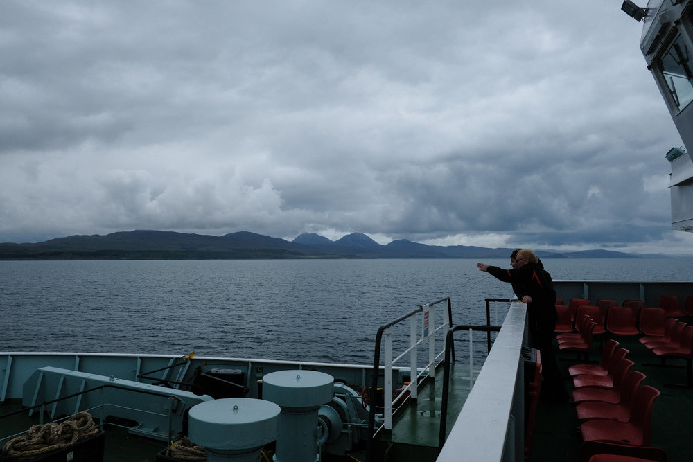 Passengers on the Caledonian MacBrayne ferry to Port Askaig, with the Isle of Jura in the background. © Adam McCauley | 2017