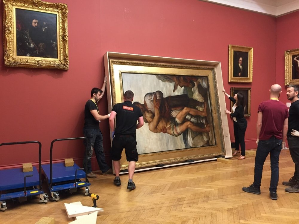 The Good Samaritan  by George Frederick Watts (1882.149) – one of our largest paintings at 3m x 2.5m – being taken down and packed in preparation for loan to the Watts Gallery in Guilford in 2017.
