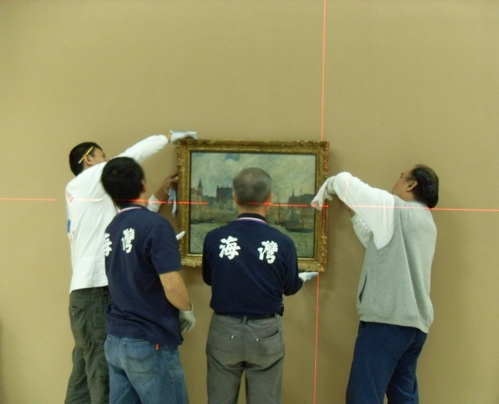 Harbour Scene, Dieppe  by Paul Gauguin (1944.46) being hung by technicians at the Taipei Fine Arts Museum in 2011