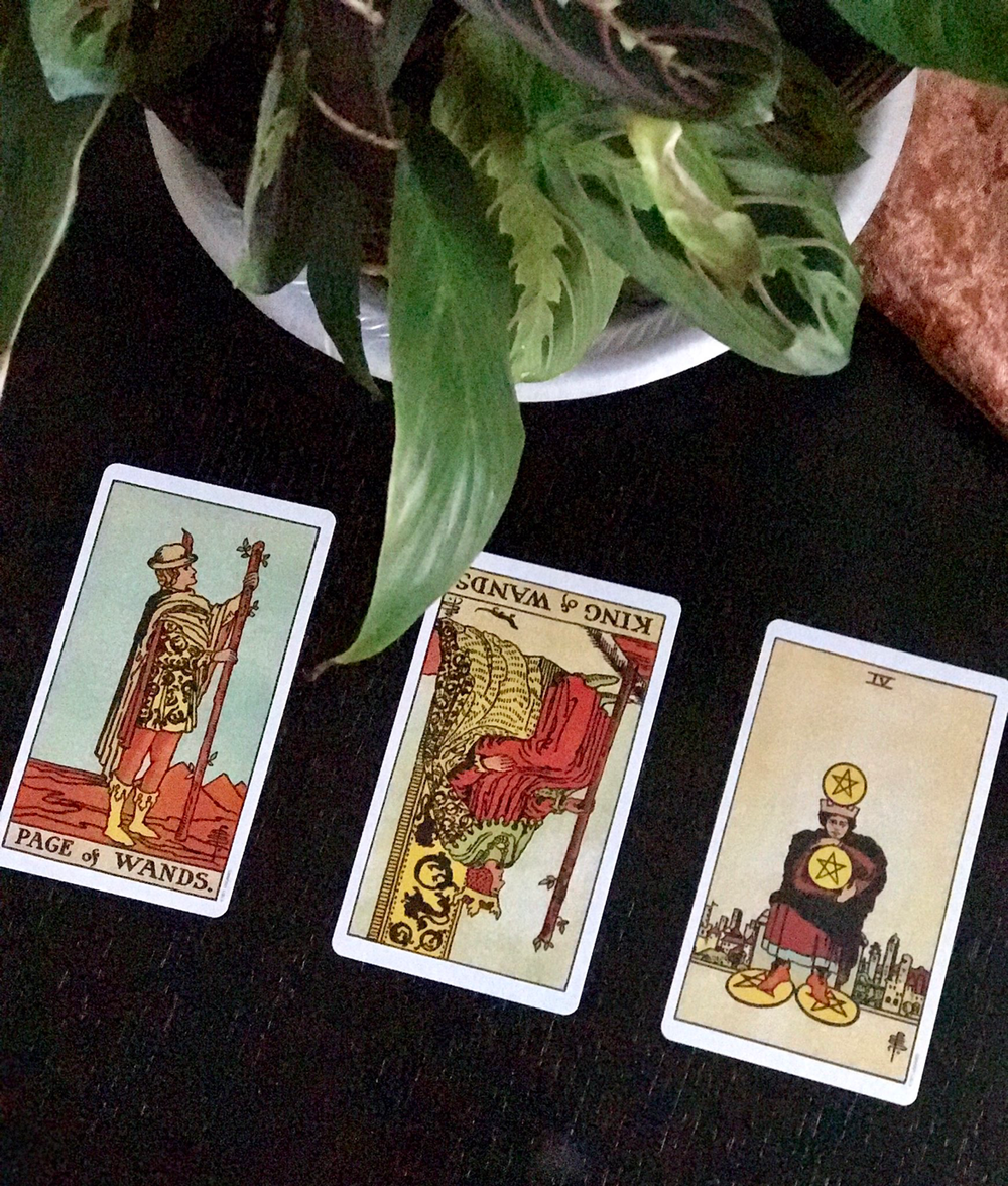 Page of Wands - King of Wands - Four of Pentacles