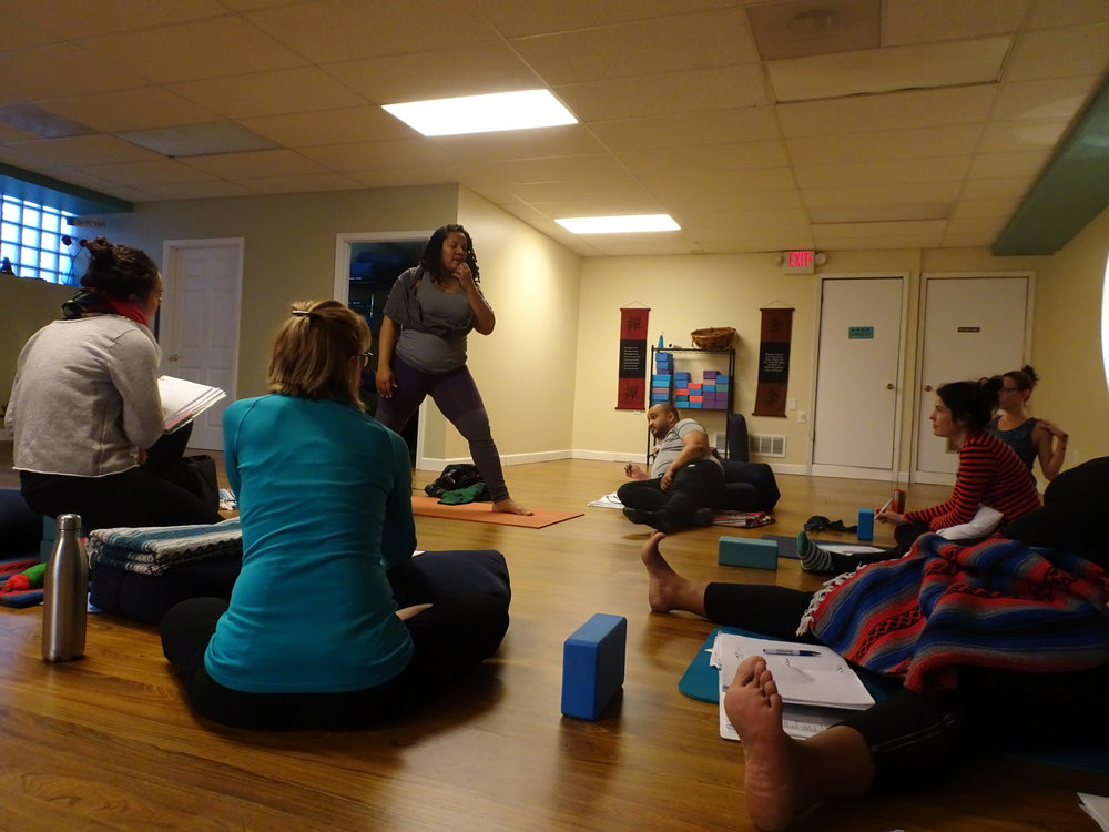 Stacy Berry, teaching yoga students at Blue Sky Yoga