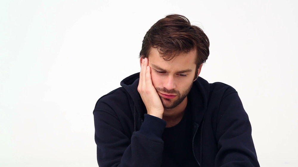 depressed-young-man-on-white-background.jpg
