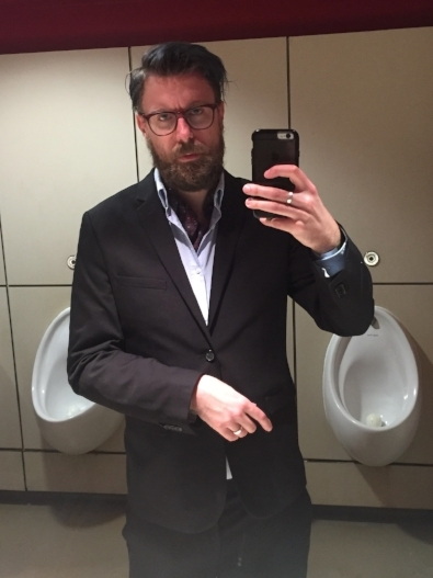 Me, in a cravat in front of some urinals. Deal with it.